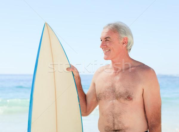 Gepensioneerd man surfboard strand glimlach sport Stockfoto © wavebreak_media
