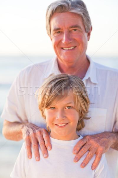 Portrait grand-père petit-fils eau sourire nature Photo stock © wavebreak_media