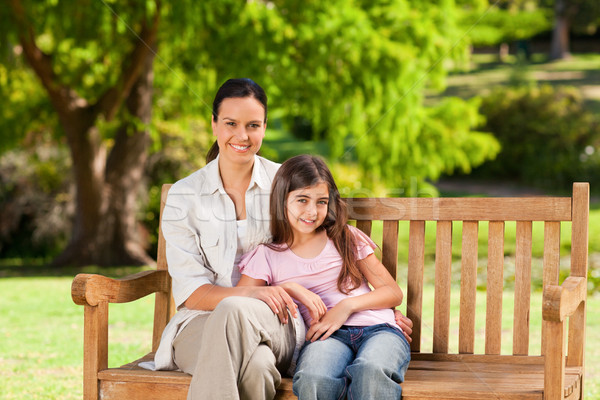 Mother and her daughter on the bench Stock photo © wavebreak_media