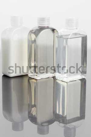 Close up of four massage oil bottles Stock photo © wavebreak_media