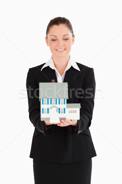 Güzel bir kadın takım elbise minyatür ev ayakta Stok fotoğraf © wavebreak_media