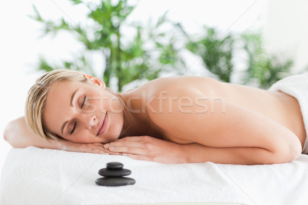 Good looking blonde woman lying on a lounger with eyes closed in a wellness center Stock photo © wavebreak_media