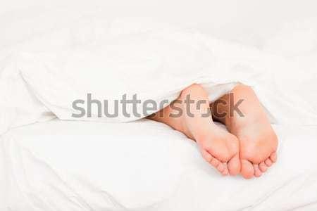 два ног кровать стены тело Сток-фото © wavebreak_media