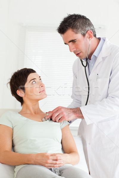 Male Doctor Examining A Female Patient In A Room Stock -4454