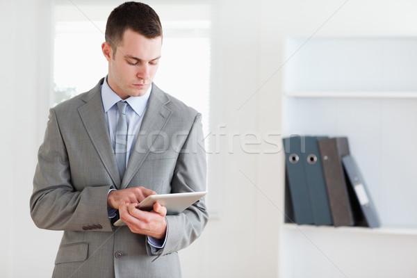Businessman reading his notes carefully Stock photo © wavebreak_media