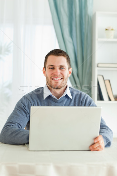 Smiling young male in his homeoffice Stock photo © wavebreak_media