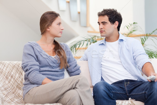 Couple having an argument while watching TV in their living room Stock photo © wavebreak_media