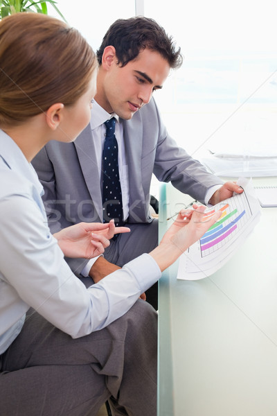 Side view of young colleagues analyzing diagram together Stock photo © wavebreak_media