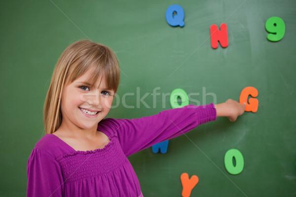Wenig Schülerin Hinweis Schreiben Klassenzimmer Mädchen Stock foto © wavebreak_media