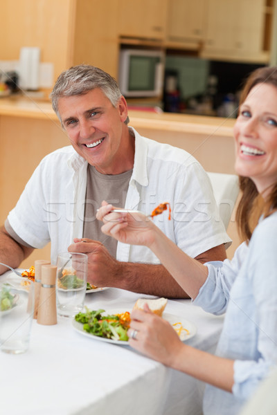 Happy couple eating their dinner together Stock photo © wavebreak_media
