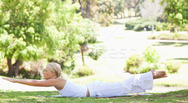 Side view of a young woman doing her exercises in the park Stock photo © wavebreak_media