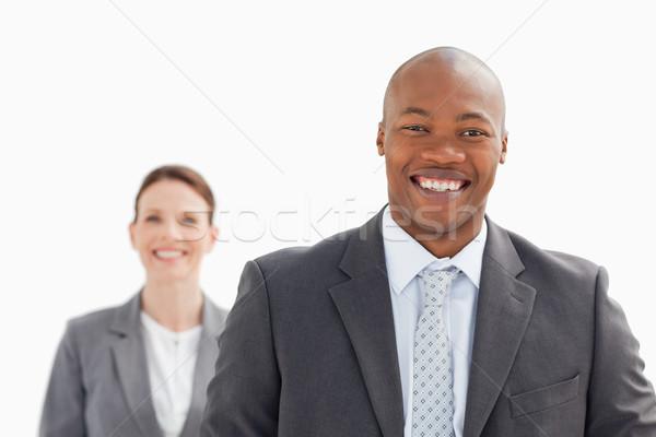 улыбаясь деловая женщина за деловой человек лице здании Сток-фото © wavebreak_media