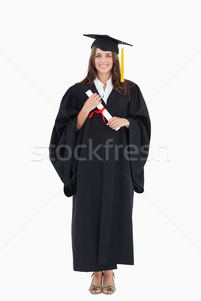 A full length shot of a woman after graduating while she looks at the camera Stock photo © wavebreak_media