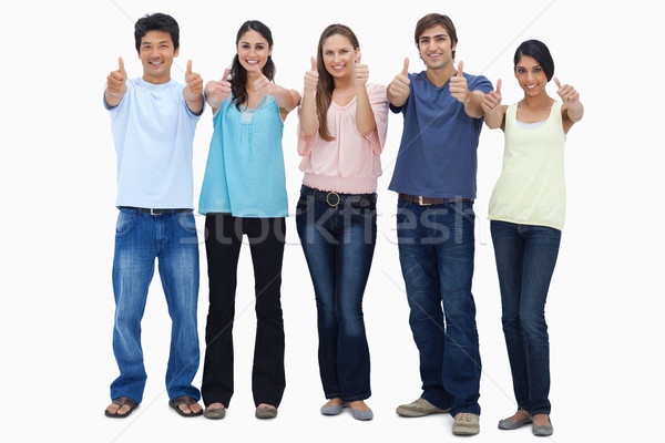 Customers approving with their thumbs-up against white background Stock photo © wavebreak_media