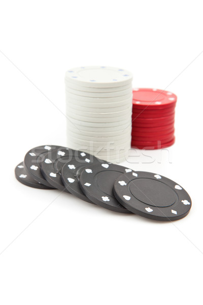 Poker tokens piled up together against a white background Stock photo © wavebreak_media
