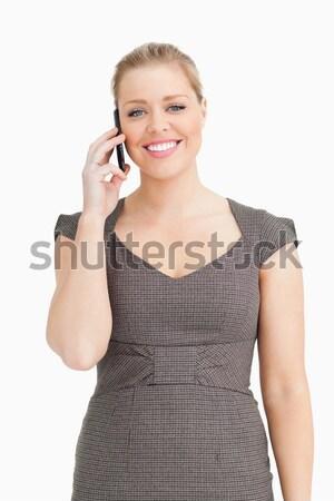женщину призыв телефон белый костюм исполнительного Сток-фото © wavebreak_media