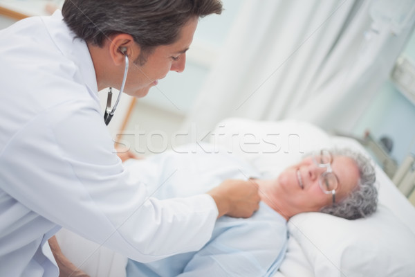 Patient is auscultating with a doctor in hospital ward Stock photo © wavebreak_media