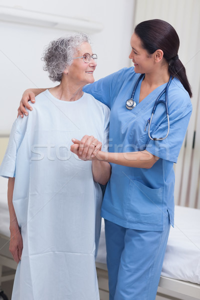 Nurse assisting an elderly patient in hospital ward Stock photo © wavebreak_media
