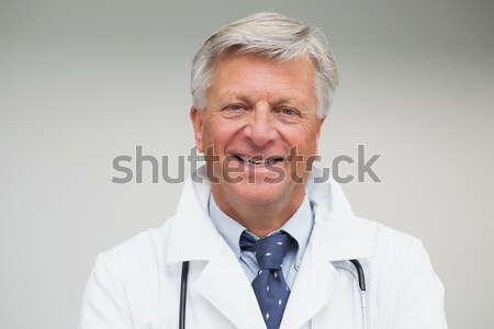 Happy bearded doctor wearing lab coat and stethoscope Stock photo © wavebreak_media