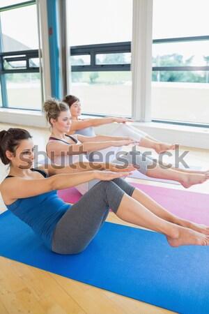 Photo stock: Heureux · femmes · yoga · classe · bateau · posent