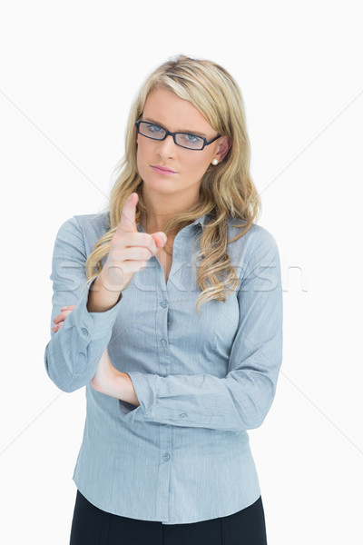 Strict blonde woman pointing  Stock photo © wavebreak_media