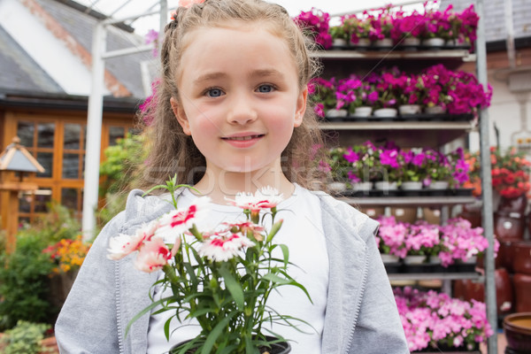 Child holding potted plant in garden center Stock photo © wavebreak_media
