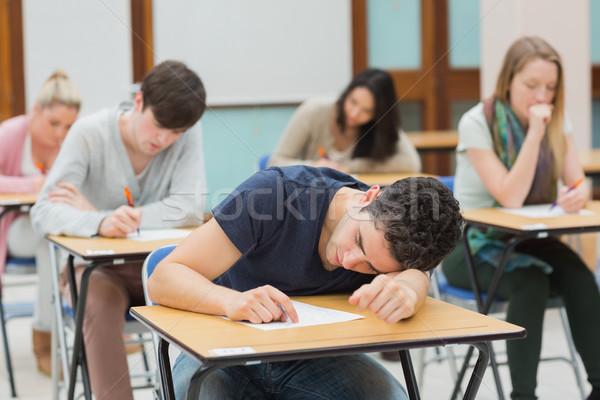Adam uyku sınav salon çalışmak kalem Stok fotoğraf © wavebreak_media
