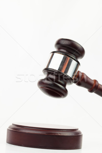 Hammer banging gavel on white background Stock photo © wavebreak_media