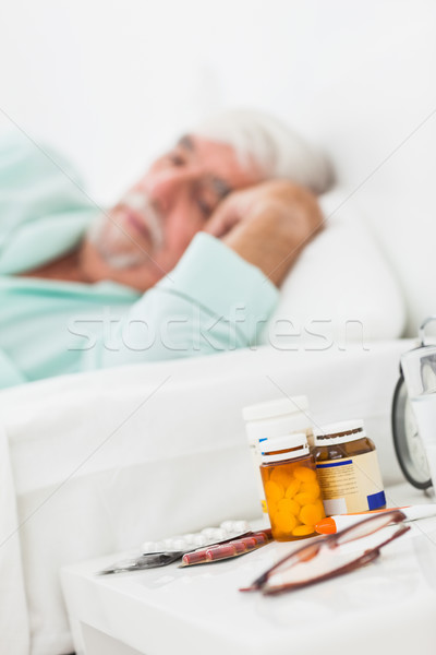Bedside table with pills and glasses Stock photo © wavebreak_media