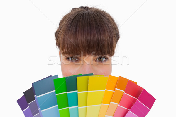 Happy woman with fringe showing colour charts close up Stock photo © wavebreak_media