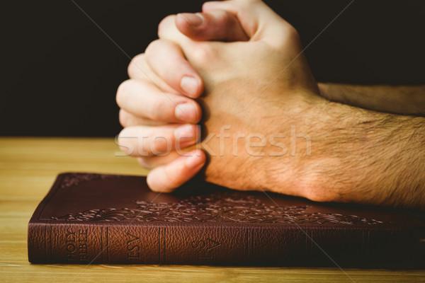 Man praying over his bible Stock photo © wavebreak_media