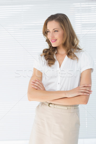 Businesswoman with arms crossed against blinds Stock photo © wavebreak_media
