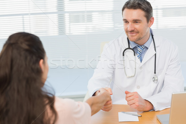 Doctor and patient shaking hands in medical office Stock photo © wavebreak_media