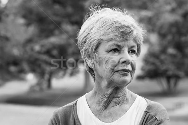 Idős nő másfelé néz park közelkép fa Stock fotó © wavebreak_media