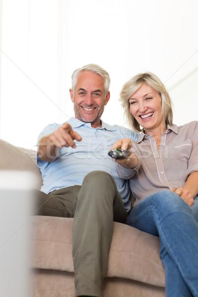Happy couple watching tv on sofa Stock photo © wavebreak_media