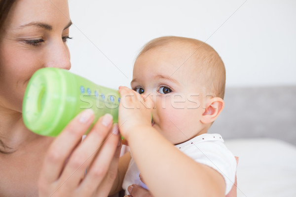 Mother feeding baby with milk bottle Stock photo © wavebreak_media