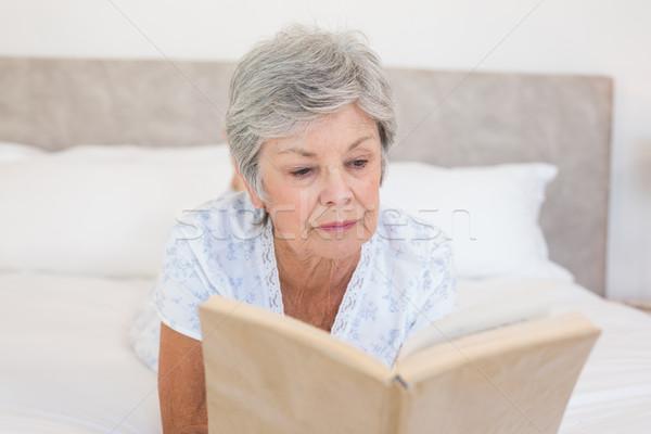 Senior woman reading story book in bed Stock photo © wavebreak_media
