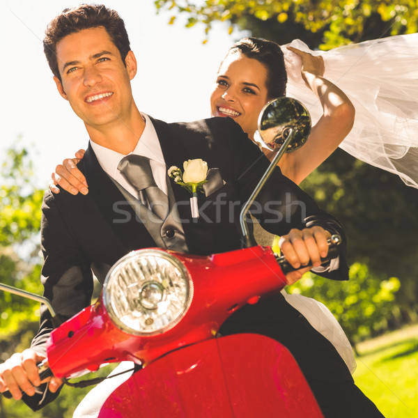 Newlywed couple enjoying scooter ride Stock photo © wavebreak_media