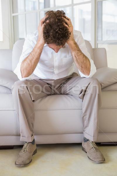 Jólöltözött férfi ül fej kezek otthon Stock fotó © wavebreak_media