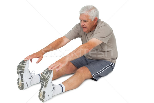 Full length of a senior man stretching hands to legs Stock photo © wavebreak_media