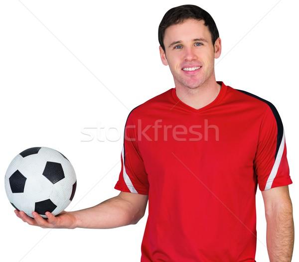 Football fan in red holding ball Stock photo © wavebreak_media