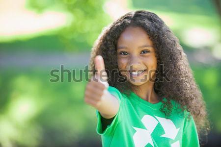 Young environmental activist smiling at the camera  Stock photo © wavebreak_media