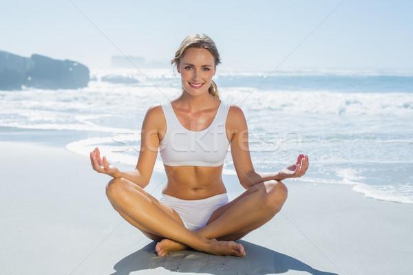Gorgeous blonde in lotus pose by the sea Stock photo © wavebreak_media