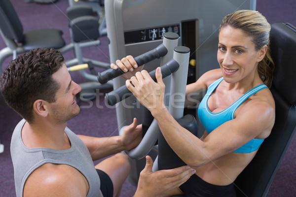Personal trainer gülen kadın vücut geliştirmeci ağırlık Stok fotoğraf © wavebreak_media
