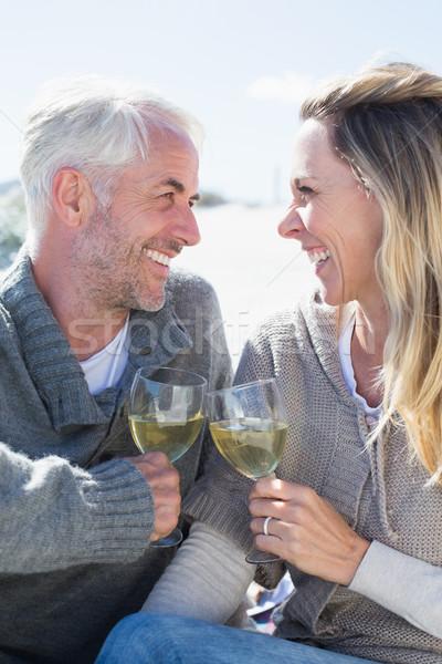 Couple enjoying white wine on picnic at the beach smiling at eac Stock photo © wavebreak_media