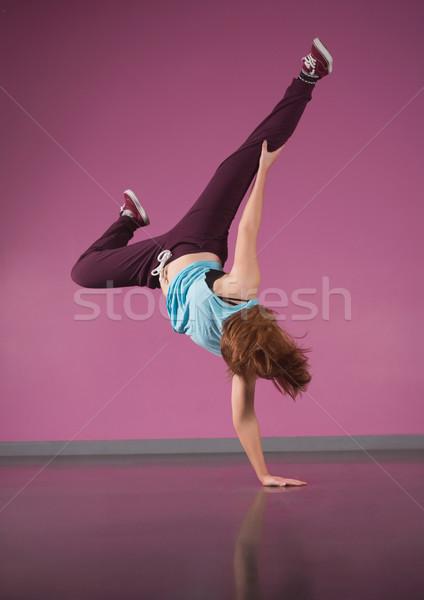 Pretty break dancer doing handstand with one hand Stock photo © wavebreak_media