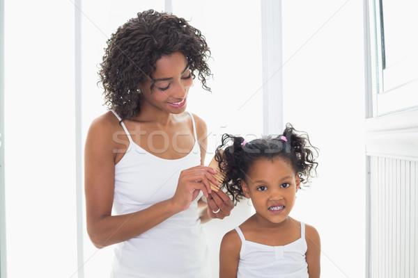 Mooie moeder haren home badkamer huis Stockfoto © wavebreak_media