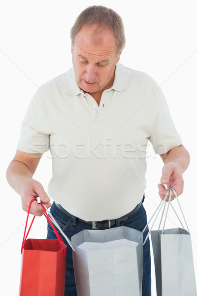 Mature man looking at his purchases Stock photo © wavebreak_media