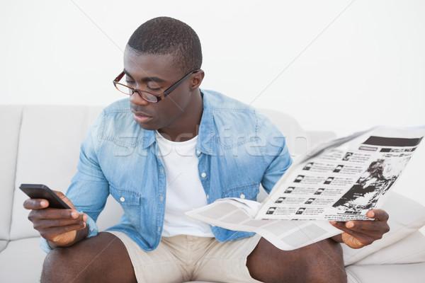 Lezser férfi ül kanapé sms chat telefon Stock fotó © wavebreak_media