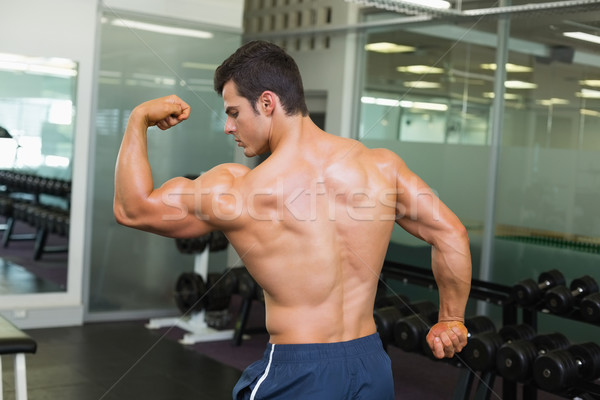 Rear view of a muscular man flexing muscles Stock photo © wavebreak_media